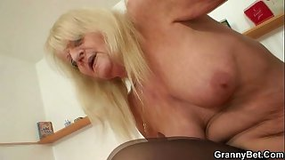 Naughty old grandma in stockings rides cock