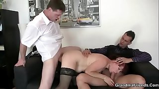 Office mature woman enjoys two cocks