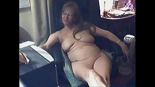 Cute horny granny having fun at PC. Amateur