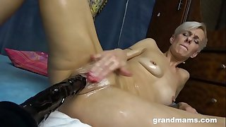 Old Slut Shoves Massive Dildo in her Worn Out Pussy