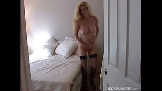 Big tits blonde MILF in stockings