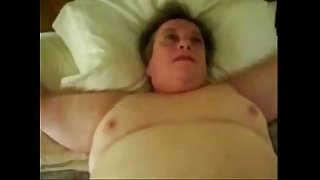 Having fun with my old slut tied on bed. Amateur older