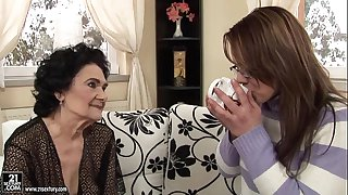 Granny Fucks a Younger Girl with Strap-on