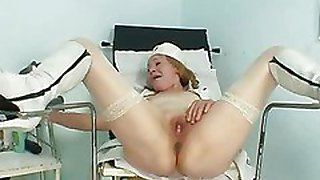 Kinky grandma wears pump boots and toys herself