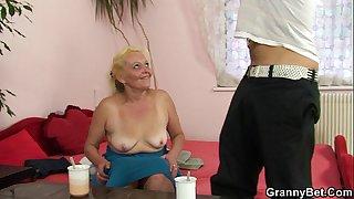Old blonde grandma enjoys riding cock