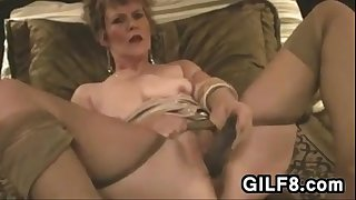 GILF Masturbating With Her Toy On The Bed