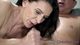 Slutty grandma with small tits sucks cock