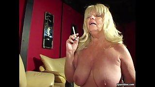 Big titted smoking granny sucks hard cock
