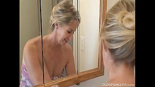 Gorgeous granny has a shower