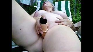 Pervert granny maturbating in court yard. Amateur older
