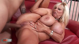 Busty mature babe banged by a vaillant fucker