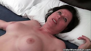 British milf Julie is toying her mature and hairy pussy
