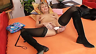 Good-looking domina wife performs strange masturbation